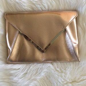 Rose gold clutch